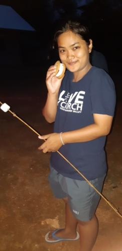 Making and eating S'More.