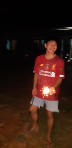 Chaiwat just enjoying burning his sparklers.