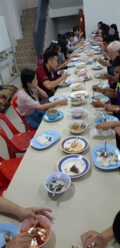 Eating dinner!  Our table keeps getting longer and longer.