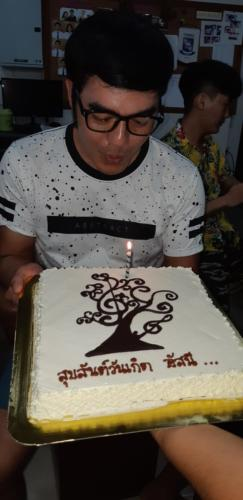 Asanee and his cake.  Blowing out the candle.