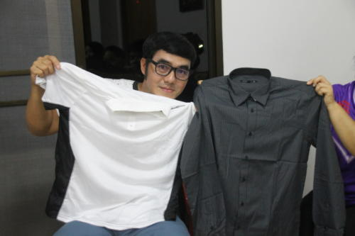 Asanee with 2 new shirts – 1 white and 1 black.