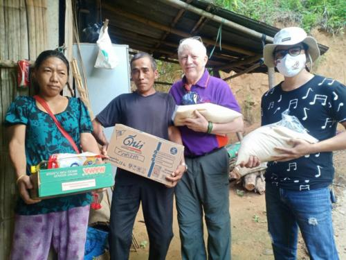 Ami, Ari, Bill & Asanee delivering food.