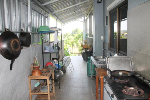 Outside kitchen, stove and pots and pans