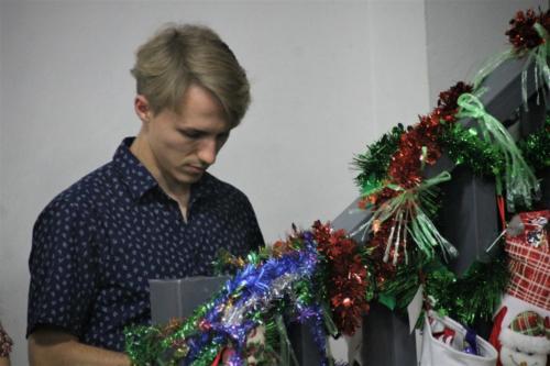 Matthew adding snacks to everyone's Christmas stocking.