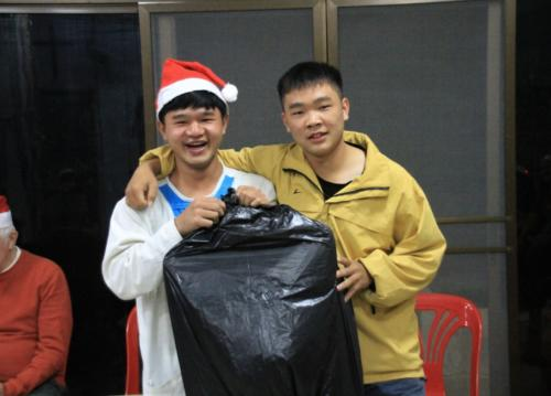 Choot gives a gift to his buddy Wat!  Very special Christmas wrapping!