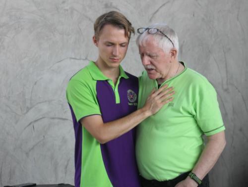 Bill & Matthew praying for each other.