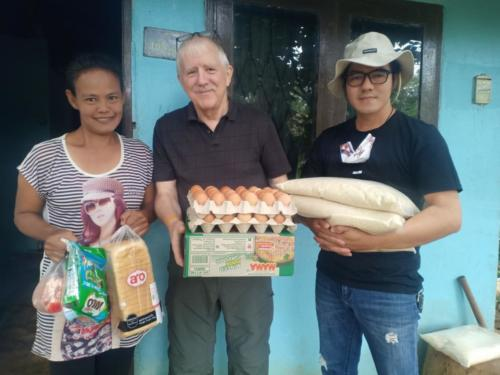 Lek, Bill & Asanee delivering food to Lek and her family.