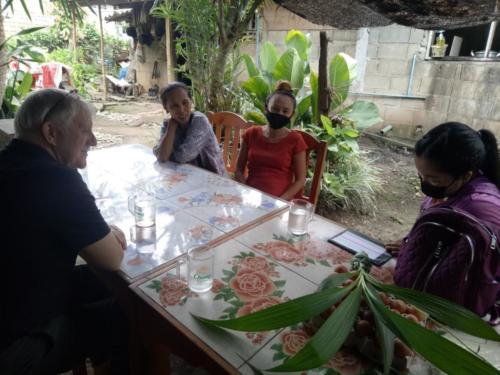 Bill, Nong's mom, Nong, Baw visiting and sharing.